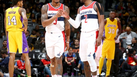 WASHINGTON, DC - NOVEMBER 9:  Bradley Beal #3 and John Wall #2 of the Washington Wizards high five during the game against the Los Angeles Lakers on November 9, 2017 at Capital One Arena in Washington, DC. NOTE TO USER: User expressly acknowledges and agrees that, by downloading and or using this Photograph, user is consenting to the terms and conditions of the Getty Images License Agreement. Mandatory Copyright Notice: Copyright 2017 NBAE (Photo by Ned Dishman/NBAE via Getty Images)