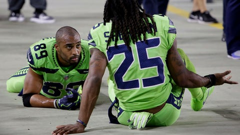 Seattle Seahawks wide receiver Doug Baldwin (89) and cornerback Richard Sherman (25) sit on the sidelines during the second half of an NFL football game against the Arizona Cardinals, Thursday, Nov. 9, 2017, in Glendale, Ariz. (AP Photo/Rick Scuteri)