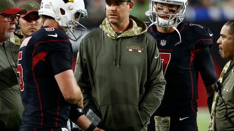 Injured Arizona Cardinals quarterback Carson Palmer, center, talks with quarterback Drew Stanton, left, and quarterback Blaine Gabbert, right, during the second half of an NFL football game against the Seattle Seahawks, Thursday, Nov. 9, 2017, in Glendale, Ariz. (AP Photo/Ross D. Franklin)