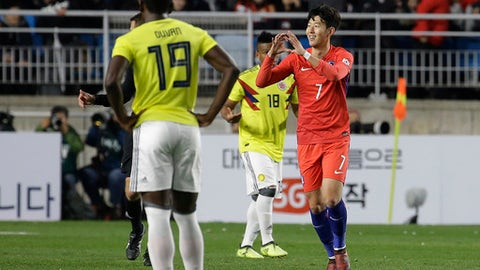 South Korea' Son Heung-min, right, celebrates after scoring a goal against Colombia during a friendly soccer match at Suwon World Cup Stadium in Suwon, South Korea, Friday, Nov. 10, 2017. (AP Photo/Ahn Young-joon)