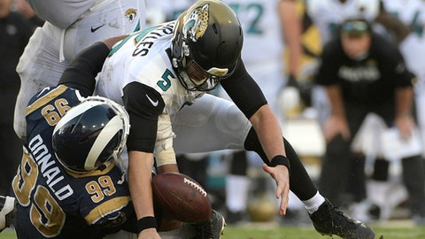 FILE - In this Oct. 15, 2017, file photo, Jacksonville Jaguars quarterback Blake Bortles (5) loses the ball as he is sacked by Los Angeles Rams defensive tackle Aaron Donald (99) during the second half of an NFL football game, in Jacksonville, Fla. Aaron Donald of the Los Angeles Rams is the unanimous choice by an Associated Press panel as the best defensive tackle in the NFL. (AP Photo/Phelan M. Ebenhack, File)