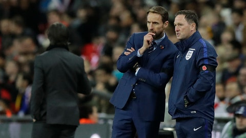 England's manager Gareth Southgate, left talks to an assistant during the international friendly soccer match between England and Germany at Wembley stadium in London, Friday, Nov. 10, 2017. (AP Photo/Matt Dunham)