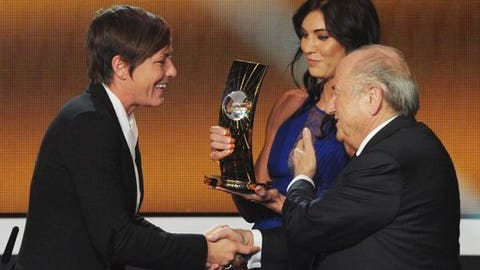 "FILE - In this Jan. 7, 2013, file photo, Abby Wambach, left, of the United States is presented the FIFA Women's World Player of the Year award by Hope Solo, center, goalkeeper of the U.S. team, and FIFA President Sepp Blatter, right, during the FIFA Ballon d'Or Gala held at the Kongresshaus in Zurich, Switzerland. Solo told a Portuguese newspaper that former FIFA President Blatter sexually assaulted her at the ceremony. In an interview published Friday, Nov. 10, 2017, in the newspaper Expresso, Solo said Blatter ""grabbed"" her inappropriately on her rear end shortly before the two appeared onstage at the awards event. (AP Photo/Keystone, Steffen Schmidt, File)"