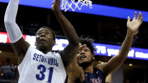 Seton Hall center Angel Delgado (31) goes up for a shot against Fairleigh Dickinson forward Mike Holloway (34) during the second half of an NCAA college basketball game, Friday, Nov. 10, 2017, in Newark, N.J. Seton Hall won 90-68. (AP Photo/Julio Cortez)