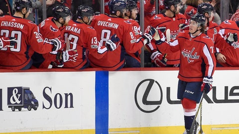 Washington Capitals right wing T.J. Oshie (77) celebrates his goal with Washington Capitals left wing Alex Ovechkin (8), of Russia, and the bench during the second period of an NHL hockey game against the Pittsburgh Penguins, Friday, Nov. 10, 2017, in Washington. (AP Photo/Nick Wass)