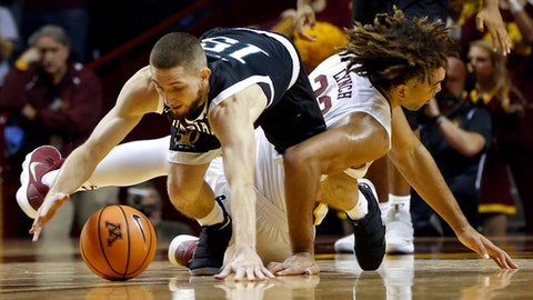 South Carolina Upstate's Pat Welch, left, and Minnesota's Reggie Lynch tumble to the floor during the first half of an NCAA college basketball game Friday, Nov. 10, 2017 in Minneapolis. (AP Photo/Jim Mone)