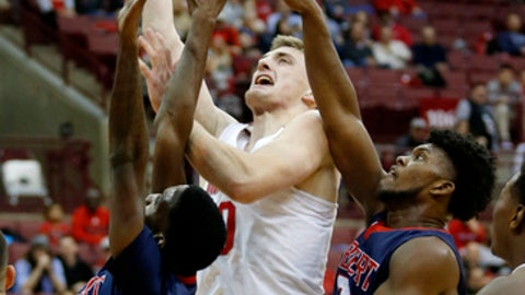 Ohio State center Micah Potter, center, goes up for a shot between Robert Morris guard Taevon Ashmeade, left, and forward David Cole during the second half of an NCAA college basketball game in Columbus, Ohio, Friday, Nov. 10, 2017. Ohio State won 95-64. (AP Photo/Paul Vernon)