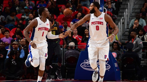 AUBURN HILLS, MI - NOVEMBER 10: Reggie Jackson #1 and Andre Drummond #0 of the Detroit Pistons high five during the game against the Atlanta Hawks on November 10, 2017 at Little Caesars Arena in Auburn Hills, Michigan. NOTE TO USER: User expressly acknowledges and agrees that, by downloading and/or using this photograph, User is consenting to the terms and conditions of the Getty Images License Agreement. Mandatory Copyright Notice: Copyright 2017 NBAE (Photo by Chris Schwegler/NBAE via Getty Images)