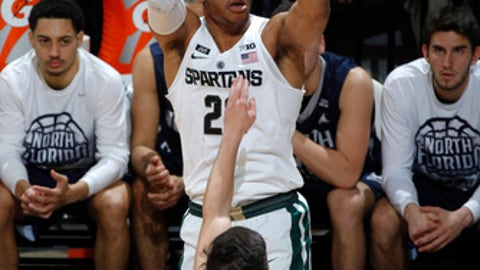 Michigan State's Miles Bridges, rear, shoots over North Florida's Ivan Gandia-Rosa (21) during the first half of an NCAA college basketball game, Friday, Nov. 10, 2017, in East Lansing, Mich. (AP Photo/Al Goldis)