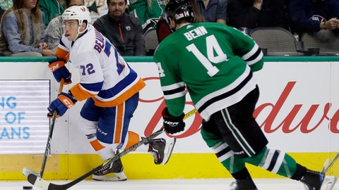 New York Islanders center Anthony Beauvillier (72) advances the puck as Dallas Stars' Jamie Benn (14) defends in the second period of an NHL hockey game, Friday, Nov. 10, 2017, in Dallas. (AP Photo/Tony Gutierrez)