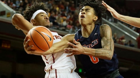 Cal State Fullerton guard Kyle Allman, right, drives to the basket past Southern California guard Elijah Stewart during the first half of an NCAA college basketball game in Los Angeles, Friday, Nov. 10, 2017. (AP Photo/Chris Carlson)