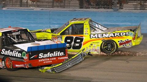Matt Crafton (88) and Ben Rhodes crash after a restart during a NASCAR Trucks series auto race at Phoenix International Raceway, Friday, Nov. 10, 2017, in Avondale, Ariz. (AP Photo/Ralph Freso)