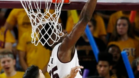 Arizona State De'Quon Lake, right, blocks the shot of Idaho State guard Geno Luzcando (1) during the second half of an NCAA basketball game Friday, Nov. 10, 2017, in Tempe, Ariz. (AP Photo/Ross D. Franklin)