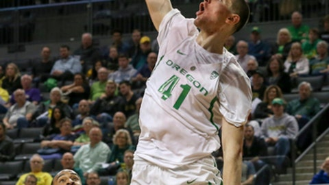 Oregon's Roman Sorkin scores against Coppin State during the first half of an NCAA college basketball game in Eugene, Ore., Friday, Nov. 10, 2017. (Collin Andrew/The Register-Guard via AP)
