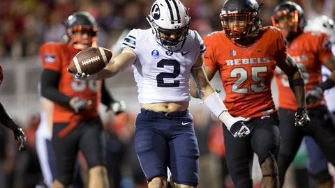 Brigham Young Cougars running back Squally Canada (22) runs the ball against the UNLV Rebels during an NCAA college football game Friday, Nov. 10, 2017, in Las Vegas. (Erik Verduzco/Las Vegas Review-Journal via AP)