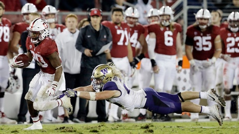 Stanford running back Bryce Love, left, runs past Washington linebacker Ben Burr-Kirven during the second half of an NCAA college football game Friday, Nov. 10, 2017, in Stanford, Calif. Stanford won 30-22. (AP Photo/Marcio Jose Sanchez)