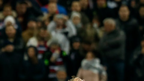 Argentina's Javier Mascherano, left, and Russia's Aleksandr Kokorin watch the ball during the international friendly soccer match between Russia and Argentina at Luzhniki World Cup 2018 stadium in Moscow, Russia, Saturday, Nov. 11, 2017. (AP Photo/Pavel Golovkin)