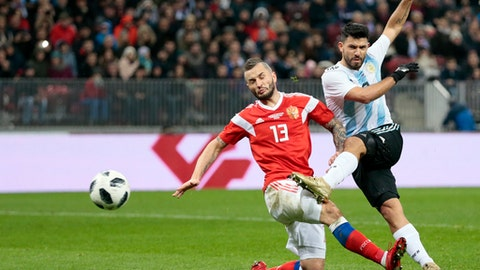 Argentina's Sergio Aguero, right, challenges Russia's Fedor Kudryashov during their international friendly soccer match between Russia and Argentina at Luzhniki stadium in Moscow, Russia, Saturday, Nov. 11, 2017. (AP Photo/Ivan Sekretarev)