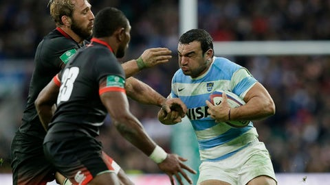 Argentina's Agustin Creevy, right, is tackled by England's Chris Robshaw, left, and England's Semesa Rokoduguni during a rugby union international match between England and Argentina at Twickenham stadium in London, Saturday, Nov. 11, 2017. (AP Photo/Tim Ireland)