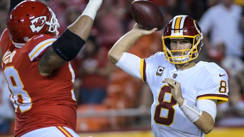 Washington Redskins quarterback Kirk Cousins (8) is pressured by Kansas City Chiefs defensive tackle Roy Miller (98) during the first half of their NFL football game in Kansas City, Mo., Monday, October 2, 2017. (AP Photo/Reed Hoffmann)