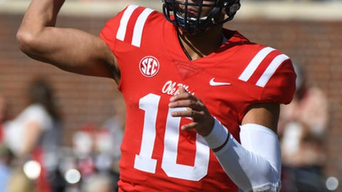 Mississippi quarterback Jordan Ta'amu (10) releases a pass during the first half of an NCAA college football game against Louisiana-Lafayette in Oxford, Miss., Saturday, Nov. 11, 2017. (AP Photo/Thomas Graning)