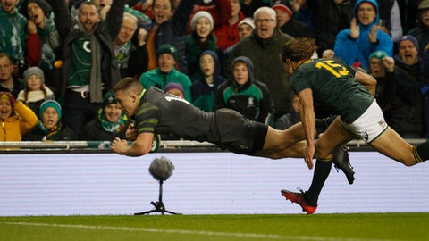 Ireland's Andrew Conway, left, scores a try against South Africa during a rugby union international match at the Aviva stadium in Dublin, Ireland, Saturday, Nov. 11, 2017. (AP Photo/Peter Morrison)