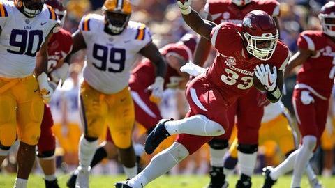 Arkansas linebacker Dee Walker (33) carries in the first half of an NCAA college football game against LSU in Baton Rouge, La., Saturday, Nov. 11, 2017. (AP Photo/Gerald Herbert)