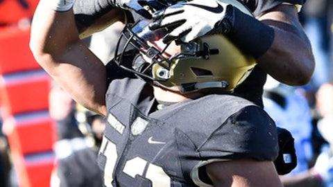 Army running back Darnell Woolfolk (33) celebrates his touchdown with teammates after scoring against the Duke during the first half of an NCAA college football game on Saturday, Nov. 11, 2017, in West Point, N.Y. (AP Photo/Hans Pennink)