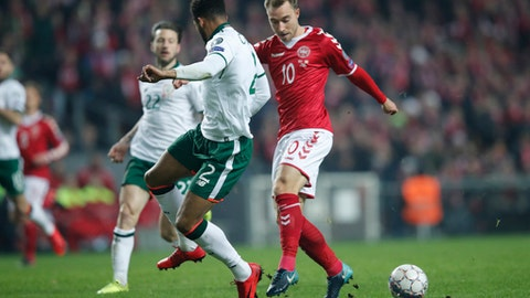 Ireland's Cyrus Christie and Denmark's Christian Eriksen , right, vie for the ball during the World Cup qualifying play-off first leg soccer match between Denmark and the Republic of Ireland at Parken stadium in Copenhagen, Denmark, Saturday, Nov. 11, 2017. (Jens Dresling/Ritzau via AP)