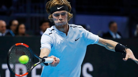 Andrey Rublev, of Russia, strikes a forehand to Hyeon Chung, of South Korea, during the ATP Next Gen tennis tournament final, in Milan, Italy, Saturday, Nov. 11, 2017. (AP Photo/Antonio Calanni)