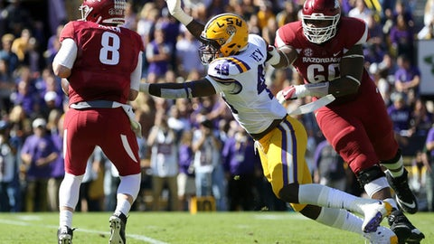 Arkansas quarterback Austin Allen (8) scrambles under pressure from LSU linebacker Arden Key (49) in the first half of an NCAA college football game in Baton Rouge, La., Saturday, Nov. 11, 2017. LSU won 33-10. (AP Photo/Gerald Herbert)
