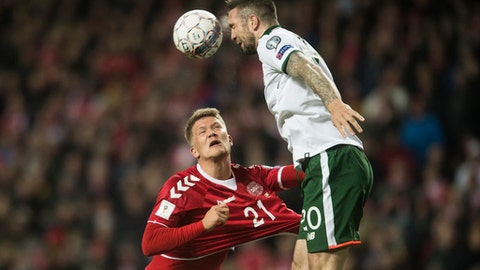 Ireland's Shane Duffy, right, and Denmark's Andreas Cornelius in action during the World Cup qualifying play-off first leg soccer match between Denmark and the Republic of Ireland at Parken stadium in Copenhagen, Denmark, Saturday, Nov. 11, 2017. (Gregers Tycho/Ritzau via AP)