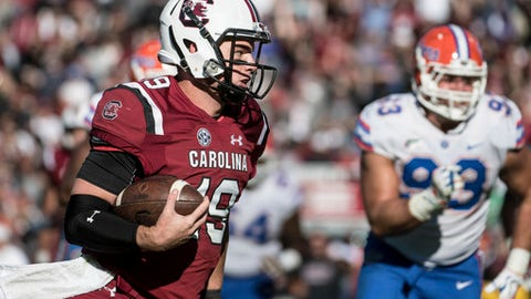 South Carolina quarterback Jake Bentley (19) runs for a touchdown against Florida during the second half of an NCAA college football game Saturday, Nov. 11, 2017, in Columbia, S.C. South Carolina defeated Florida 28-20. (AP Photo/Sean Rayford)