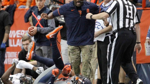 Syracuse head coach Dino Babers yells when a penalty is not called on a play in the second quarter of an NCAA college football game against Wake Forest in Syracuse, N.Y., Saturday, Nov. 11, 2017. (AP Photo/Nick Lisi)