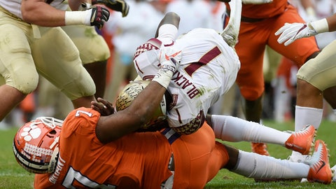 Clemson defensive end Austin Bryant (7) sacks Florida State quarterback James Blackman (1) during the first half of an NCAA college football game, Saturday, Nov. 11, 2017, in Clemson, S.C. (AP Photo/Rainier Ehrhardt)