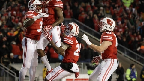 Wisconsin's Leon Jacobs is congratulated after running back a fumble for a touchdown during the second half of an NCAA college football game against Iowa Saturday, Nov. 11, 2017, in Madison, Wis. (AP Photo/Morry Gash)