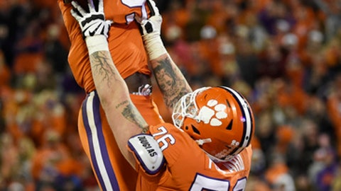 Clemson running back Travis Etienne (9) celebrates his touchdown against Florida State with teammate Sean Pollard (76) during the second half of an NCAA college football game, Saturday, Nov. 11, 2017, in Clemson, S.C. (AP Photo/Rainier Ehrhardt)