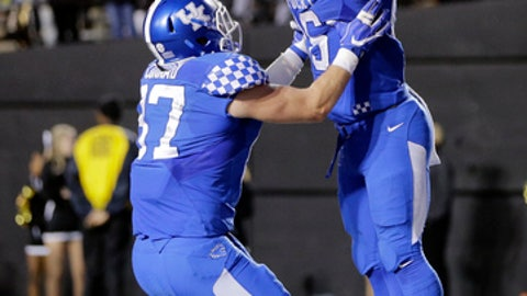 Kentucky running back Benny Snell Jr. (26) celebrates with tight end C. J. Conrad (87) after scoring a touchdown on a 6-yard run against Vanderbilt in the second half of an NCAA college football game Saturday, Nov. 11, 2017, in Nashville, Tenn. (AP Photo/Mark Humphrey)