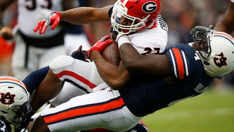 Georgia running back Nick Chubb is tackled by Auburn linebacker Jeff Holland during the first half of an NCAA college football game on Saturday, Nov. 11, 2017, in Auburn, Ala. (AP Photo/Brynn Anderson)