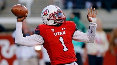 Utah quarterback Tyler Huntley (1) passes against Washington State in the first half during an NCAA college football game Saturday, Nov. 11, 2017, in Salt Lake City. (AP Photo/Rick Bowmer)