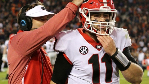 Georgia head coach Kirby Smart gives quarterback Jake Fromm a pat on the helmet as he walks off the field during a 40-17 loss to Auburn in an NCAA college football game at Jordan-Hare Stadium, Saturday, Nov. 11, 2017, in Auburn, Ala. (Curtis Compton/Atlanta Journal-Constitution via AP)