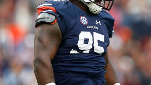 Auburn defensive lineman Dontavius Russell celebrates a tackle against Georgia during the first half of an NCAA college football game Saturday, Nov. 11, 2017, in Auburn, Ala. (AP Photo/Brynn Anderson)