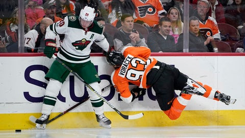 Philadelphia Flyers' Jakub Voracek, right, is sent flying after a collision with Minnesota Wild's Ryan Suter during the second period of an NHL hockey game, Saturday, Nov. 11, 2017, in Philadelphia. (AP Photo/Matt Slocum)