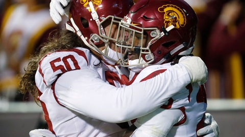 USC guard Toa Lobendahn, left, congratulates running back Ronald Jones II after his touchdown run against Colorado in the second half of an NCAA college football game Saturday, Nov. 11, 2017, in Boulder, Colo. USC won 38-24. (AP Photo/David Zalubowski)