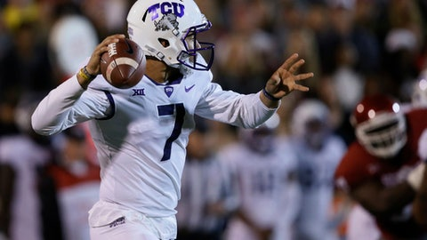 TCU quarterback Kenny Hill (7) passes in the first quarter of an NCAA college football game against Oklahoma in Norman, Okla., Saturday, Nov. 11, 2017. (AP Photo/Sue Ogrocki)