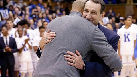 Duke head coach Mike Krzyzewski hugs former player Shane Battier following Krzyzewski's 1000th win at Duke in an NCAA college basketball game against Utah Valley in Durham, N.C., Saturday, Nov. 11, 2017. Duke won 99-69. (AP Photo/Gerry Broome)
