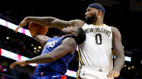 NEW ORLEANS, LA - NOVEMBER 11:  DeMarcus Cousins #0 of the New Orleans Pelicans blocks the shot of Jawun Evans #1 of the LA Clippers during the second half at the Smoothie King Center on November 11, 2017 in New Orleans, Louisiana. NOTE TO USER: User expressly acknowledges and agrees that, by downloading and or using this photograph, User is consenting to the terms and conditions of the Getty Images License Agreement.  (Photo by Sean Gardner/Getty Images)