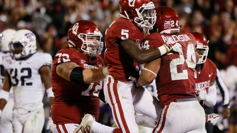 Oklahoma running back Rodney Anderson (24) celebrates a touchdown with teammates Marquise Brown (5) and Ben Powers (72) in the second quarter of an NCAA college football game against TCU in Norman, Okla., Saturday, Nov. 11, 2017. (AP Photo/Sue Ogrocki)