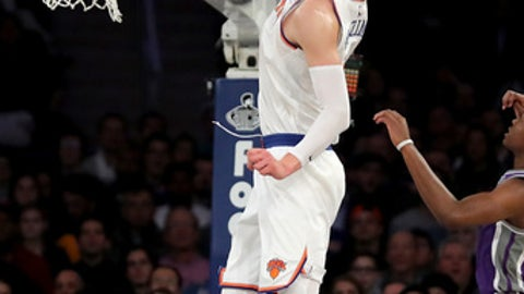 NEW YORK, NY - NOVEMBER 11:  Kristaps Porzingis #6 of the New York Knicks dunks against the Sacramento Kings in the second half during their game at Madison Square Garden on November 11, 2017 in New York City. NOTE TO USER: User expressly acknowledges and agrees that, by downloading and or using this photograph, User is consenting to the terms and conditions of the Getty Images License Agreement.  (Photo by Abbie Parr/Getty Images)