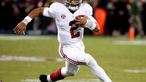 Alabama quarterback Jalen Hurts carries for a short gain against Mississippi State during the second half of an NCAA college football game in Starkville, Miss., Saturday, Nov. 11, 2017. Alabama won 31-24. (AP Photo/Rogelio V. Solis)